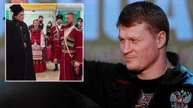 Russian heroes: Boxing star Povetkin is met by a COSSACK CHOIR at airport as crowds line streets for new MMA champ Nemkov (VIDEO)