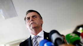 'You only know how to do evil': Brazil's Bolsonaro calls journalists 'wimps,' says they are less likely to endure Covid-19