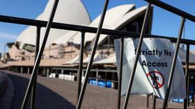 Australian man caught in girlfriend's cupboard after repeatedly breaching coronavirus quarantine gets SIX MONTHS behind bars