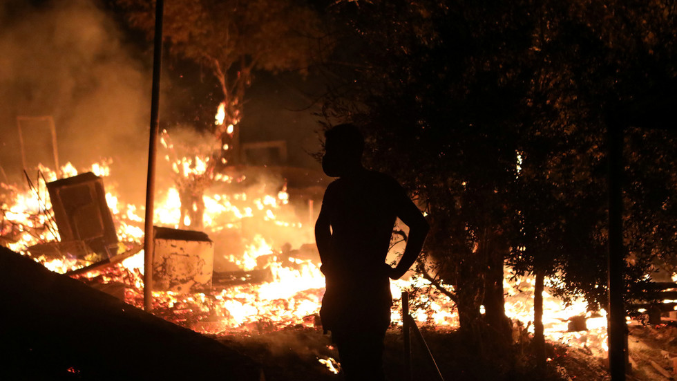 Fire ravages overcrowded, coronavirus-stricken migrant camp in Lesbos, Greece after protests over quarantine, living conditions