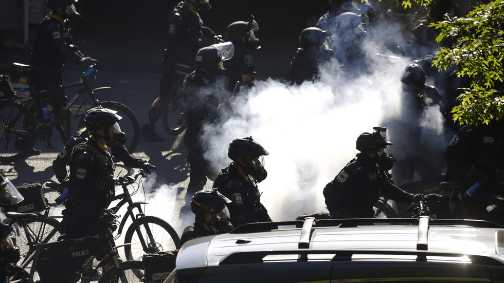 Shocking VIDEO shows Seattle cop pushing his bike over man's HEAD amid fresh wave of violent protests