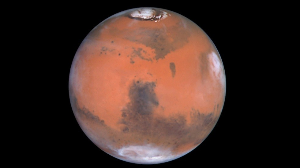 More water on Mars: Researchers say they found SALTY LAKES under red planet's polar ice cap