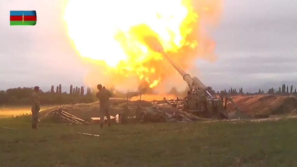 Armenia claims Azerbaijani artillery attacks are intensifying as Nagorno-Karabakh officials allege they've downed Azeri warplane