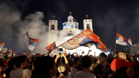 Opposition supporters celebrate election victory outside the Cathedral of the Resurrection of Christ in Podgorica, Montenegro August 31, 2020.