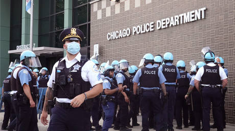 FILE PHOTO: Chicago police stand guard as demonstrators protest outside the department's 7th District station on August 11, 2020 in Chicago, Illinois
