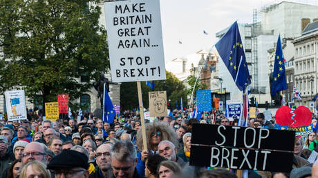 Anti-Brexit protesters take part in 'Together for the Final Say' rally in Parliament Square as hundreds of thousands of people marched through central London to demand a public vote on the outcome of Brexit on 19 October, 2019 in London, England.