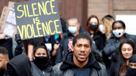 Boxer Anthony Joshua is seen with protestors during a Black Lives Matter protest in Watford, following the death of George Floyd who died in police custody in Minneapolis, Watford, Britain, June 6, 2020. © REUTERS/Paul Childs