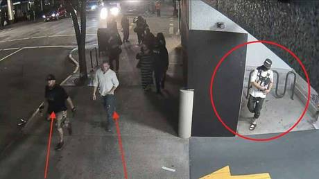 Surveillance footage released by police allegedly shows Michael Reinoehl (circled) as he prepares to follow two Patriot Prayer group members before shooting and killing one of the men.