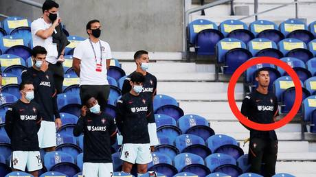Put your mask on! Cristiano Ronaldo REPRIMANDED for failing to wear face-covering as he watched Portugal game (VIDEO)