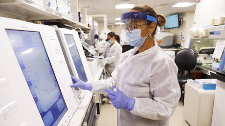 FILE PHOTO: Adriana Cardenas, a medical technologist processes test samples for the coronavirus at the AdventHealth Tampa labs on June 25, 2020 in Tampa, Florida.