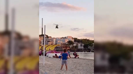 'Hitler would be proud': Video of airborne Spanish police berating beachgoers over Covid-19 triggers bleak comparisons online