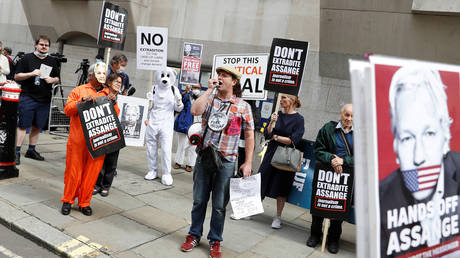 Supporters of WikiLeaks founder Julian Assange are seen outside the Old Bailey, the Central Criminal Court during a hearing to decide whether Assange should be extradited to the United States, in London, Britain September 7, 2020.