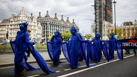 Members of the Ocean Rebellion group march during an Extinction Rebellion protest in London, Britain, September 6, 2020.