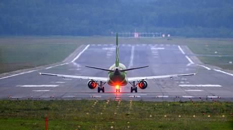 FILE PHOTO: An Embraer E170 SU passenger plane of S7 airlines is preparing to take off at the Dmitry Hvorostovsky international airport in Krasnoyarsk.