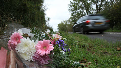 FILE PHOTO. Flowers lay on the roadside near RAF Croughton in Northamptonshire Harry Dunn was killed.