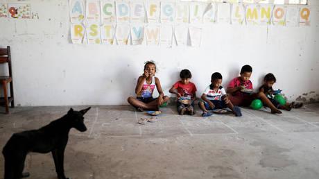 Schoolchildren eat during class recess at Sao Jose school in Morro Do Veridiano, Brazil