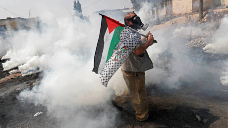Israeli security forces fire tear gas as Palestinians protest a peace deal with Bahrain in Kafr Qaddum, West Bank, September 11, 2020.
