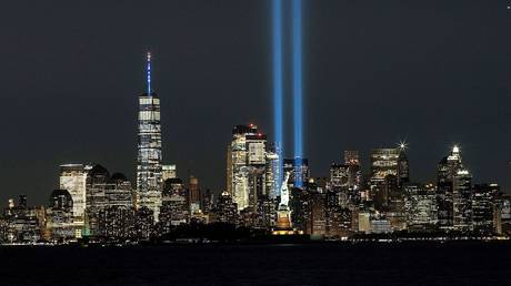 The One World Trade Center is seen as the Tribute in Light shines to commemorate the 19th anniversary of the 9/11 attacks, in New York City, September 11, 2020.