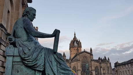 A statue of David Hume on Edinburgh's High Street, photographed in 2017 © Wikipedia