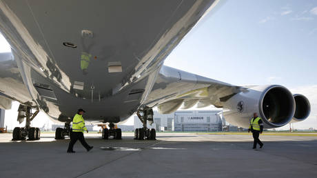 Ground staff stand under Airbus A380 aircraft for Air France KLM