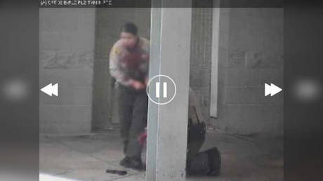A wounded sheriff's deputy (L) and her partner are shown in a photo posted on Twitter by Bill Melugin of Fox 11 Los Angeles.