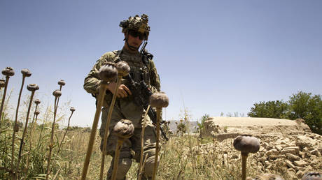 FILE PHOTO: A US Army sergeant walks while on patrol in the Zharay district of Kandahar province, Afghanistan.