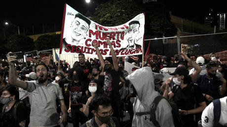 People shout slogans during the sixth day of protest against police brutality on September 14, 2020 in Medellin, Colombia