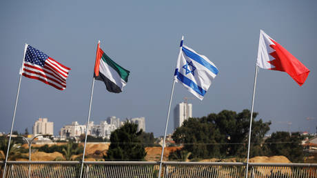 The flags of the U.S., United Arab Emirates, Israel and Bahrain flutter along a road in Netanya, Israel September 14, 2020.