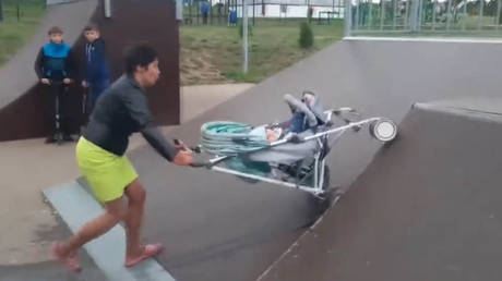 'Drunk' Russian mother faces investigation, could lose her kids after tipping baby out of pram while pushing it up a skate ramp