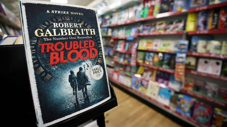 """JK Rowling's latest book """"Troubled Blood"""", written under pseudonym Robert Galbraith, is pictured at a bookstore in Hanley, Stoke-on-Trent, Britain, September 15, 2020."""