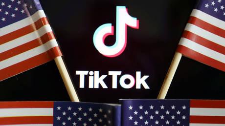 FILE PHOTO: US flags near a TikTok logo © Reuters / Florence Lo