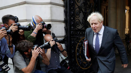 Britain's Prime Minister Boris Johnson returns to 10 Downing Street after a cabinet meeting in London, Britain, September 15, 2020