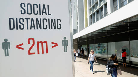FILE PHOTO. A social distancing sign is seen in Oxford Street in London, Britain J