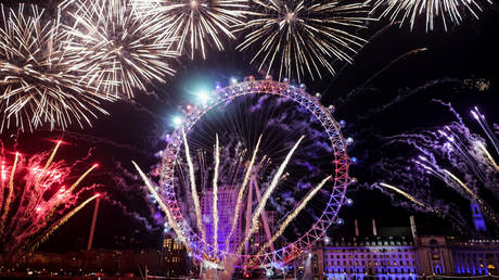 Fireworks explode over the London Eye wheel during New Year celebrations in central London, Britain, January 1, 2020.