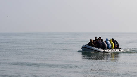 Migrants land on Deal beach after crossing the English channel from France in a dinghy on September 14, 2020 in Deal, England