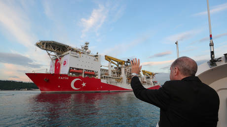 FILE PHOTO: Turkish President Tayyip Erdogan waves to a drilling vessel