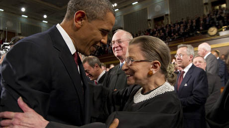 FILE PHOTO: Former US president Barack Obama greets Supreme Court Justice Ruth Bader Ginsburg before his 2012 State of the Union address in Washington, DC.