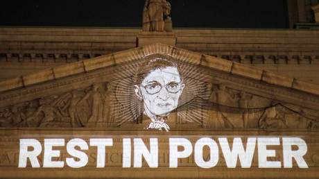 An image of Ruth Bader Ginsburg is projected onto the New York State Civil Supreme Court building in Manhattan, New York City