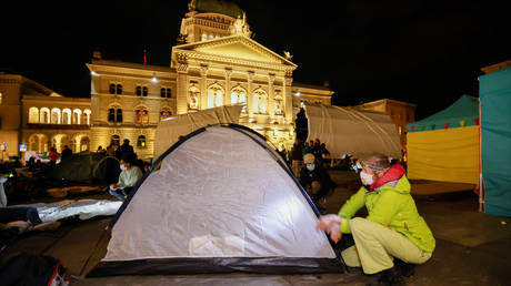 Climate change activists build tents in Bern September 21, 2020.