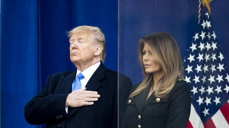 The 45th President Donald J. Trump with his hand on his heart and the First Lady Melania Trump with her arms at her side in Madison Square Park in the Manhattan borough of New York on November 11, 2019, USA