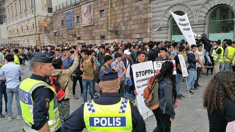 FILE PHOTO: Afghani refugee children stage a protest after Swedish immigration office denied their asylum requests, in front the Parliament building in Stockholm, Sweden on August 9, 2017