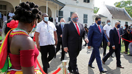 Suriname's President Chan Santokhi and U.S. Secretary of State Mike Pompeo walk together, in Paramaribo, Suriname September 17, 2020