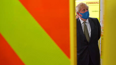 FILE PHOTO: Britain's Prime Minister Boris Johnson wears a protective mask as he visits headquarters of the London Ambulance Service NHS Trust, amid the spread of the coronavirus disease (COVID-19), in London, Britain July 13, 2020