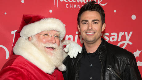 "FILE PHOTO: Actor Jonathan Bennett (R) attends Hallmark Channel's 10th Anniversary of ""Countdown To Christmas"" screening and party at 189 by Dominique Ansel on November 20, 2019 in Los Angeles, California."