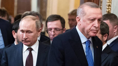 FILE PHOTO: Russian President Vladimir Putin and Turkish President Tayyip Erdogan arrive for a news conference following their talks in Moscow, Russia March 5, 2020.