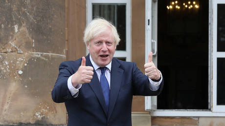 Boris Johnson gestures as he visits the Hillsborough Castle, in Belfast, Northern Ireland, August 13, 2020 © Reuters / Brian Lawless