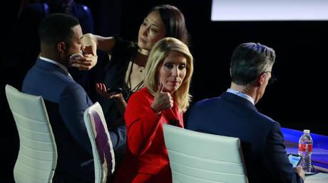 FILE PHOTO: CNN pundits Don Lemon, Dana Bash and Jake Tapper during a break at a Democratic primary debate in Detroit, Michigan.