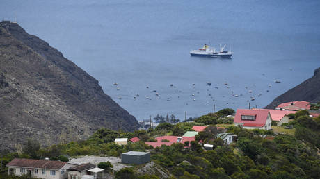 "FILE PHOTO: The RMS ""St Helena"" sails in the harbour on October 26, 2017 in Jamestown, Saint Helena."