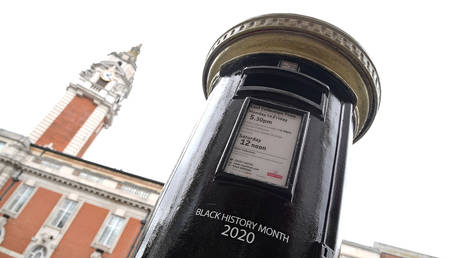 A Royal Mail postbox, painted black instead of traditional red, to honour Black Britons, as part of the forthcoming Black History Month, in Brixton, London, Britain, September 30, 2020.