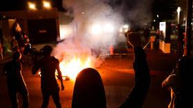'Burn it down!' WATCH Portland's BLM protesters set fire outside police precinct & enter RAP BATTLE with cops